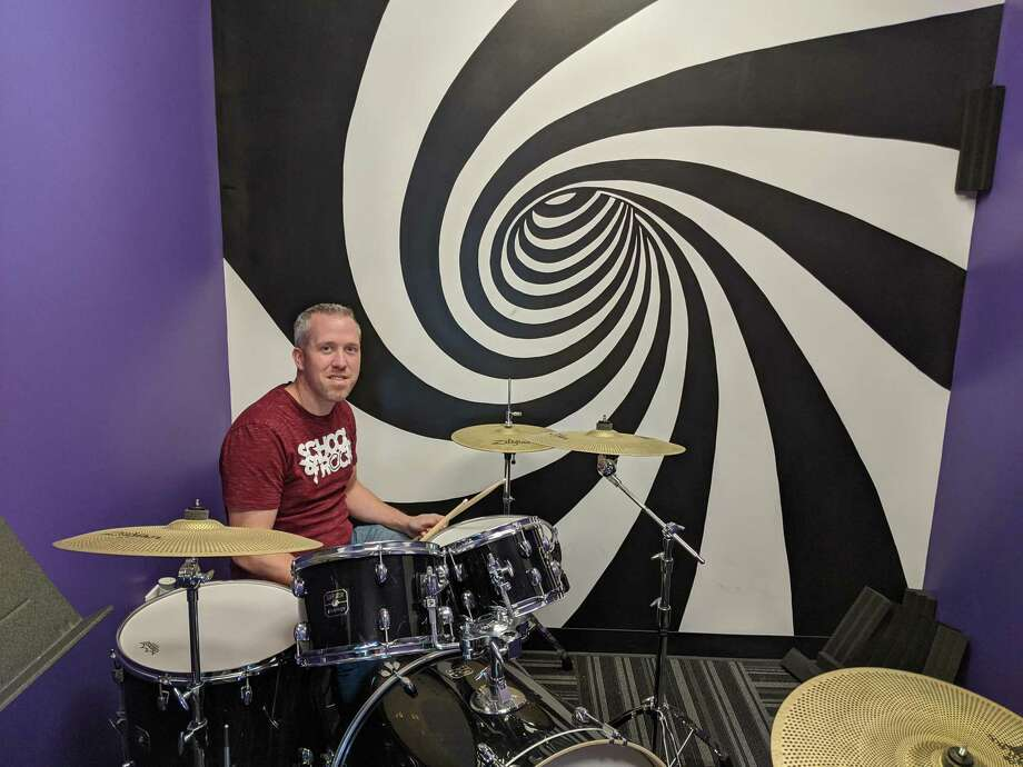 David Ireland of Spring opened up Spring School of Rock, 2111 N. Freeway, back in August. The school teaches kids and adults the fundamentals in various instruments, putting them in bands to learn famous rock songs. Photo: Paul Wedding