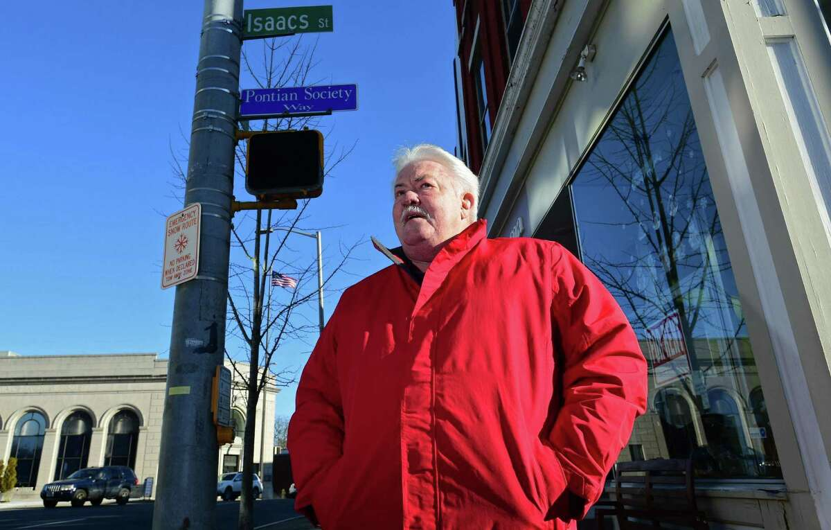 """Norwalk resident Ed Isaacs on Isaacs Street Friday, December 20, 2019, in Norwalk, Conn. Almost 25 years after city changed street name, people still call it Isaac Street. The street was named after the Isaacs family, but signs have incorrectly named it """"Isaac"""" Street."""