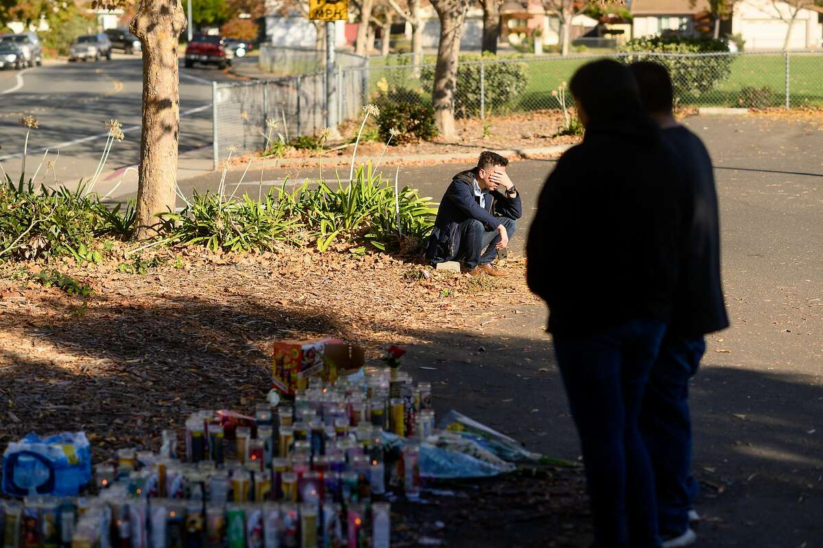 The father of a boy killed in the Searles Elementary School parking lot, who declined to give his name, mourns at the shooting site on Sunday, Nov. 24, 2019, in Union City, Calif. Authorities are searching for suspects in the fatal shooting of two boys, age 11 and 14, early Saturday morning.