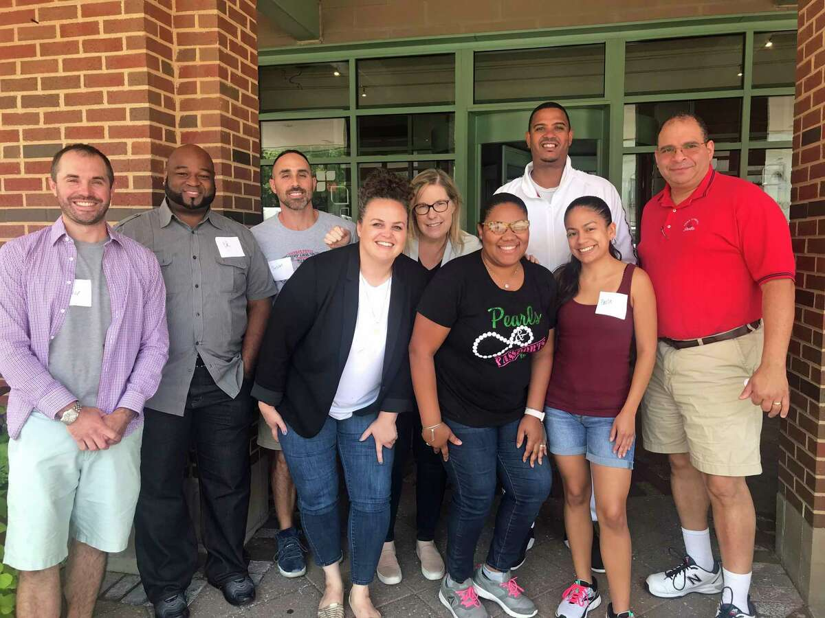 Norwalk Public Schools educators at training provided by the International Institute of Restorative Practices, in Chicago, Illinois, summer 2019. From left to right, Louis Schede, Edward Singleton, Jason Zakhar, Ellen Knapp, Barbara Wood, LaShante' James, James Crouch, Paola Perez and Robert Ayala.