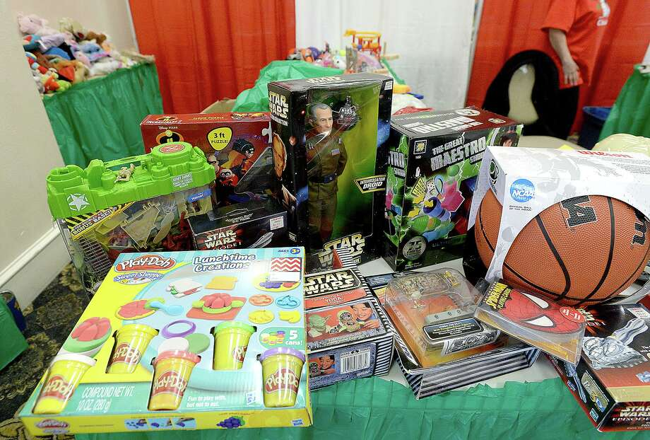 New toys donated by school groups and area businesses sit amid the tables filled with toys and other gifts at the annual distribution of the EJ Empty Stocking Fund gifts to families in need at the Compro Event Center.  Photo taken Wednesday, December 5, 2018  Kim Brent/The Enterprise Photo: Kim Brent / Kim Brent/The Enterprise / BEN