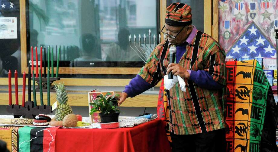 Baba Thomas Bradford gives the Libation, a ritual pouring of a liquid, or grains such as rice, as an offering to a god or spirit, or in memory of the dead during the 25th annual Kwanzaa celebration at the Stamford Government Center on Dec. 27, 2019 in Stamford, Connecticut. Guests were treated to live drum performances lead by Master Drummer Henry Jones, dancing, cultural expression and Kwanzaa Highlights by Baba E. Phillip McKain. After the ceremony, children were able to play a variety of African instruments collected throughout the years by Jones. Photo: Matthew Brown / Hearst Connecticut Media / Stamford Advocate