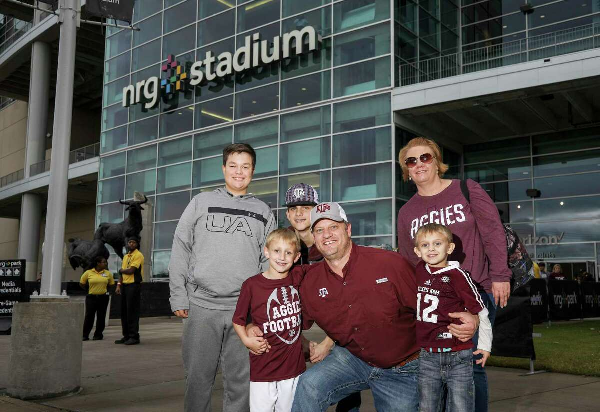 Fans pose for a photo before the Texas Bowl at NRG Stadium on Friday, Dec. 27, 2019, in Houston.