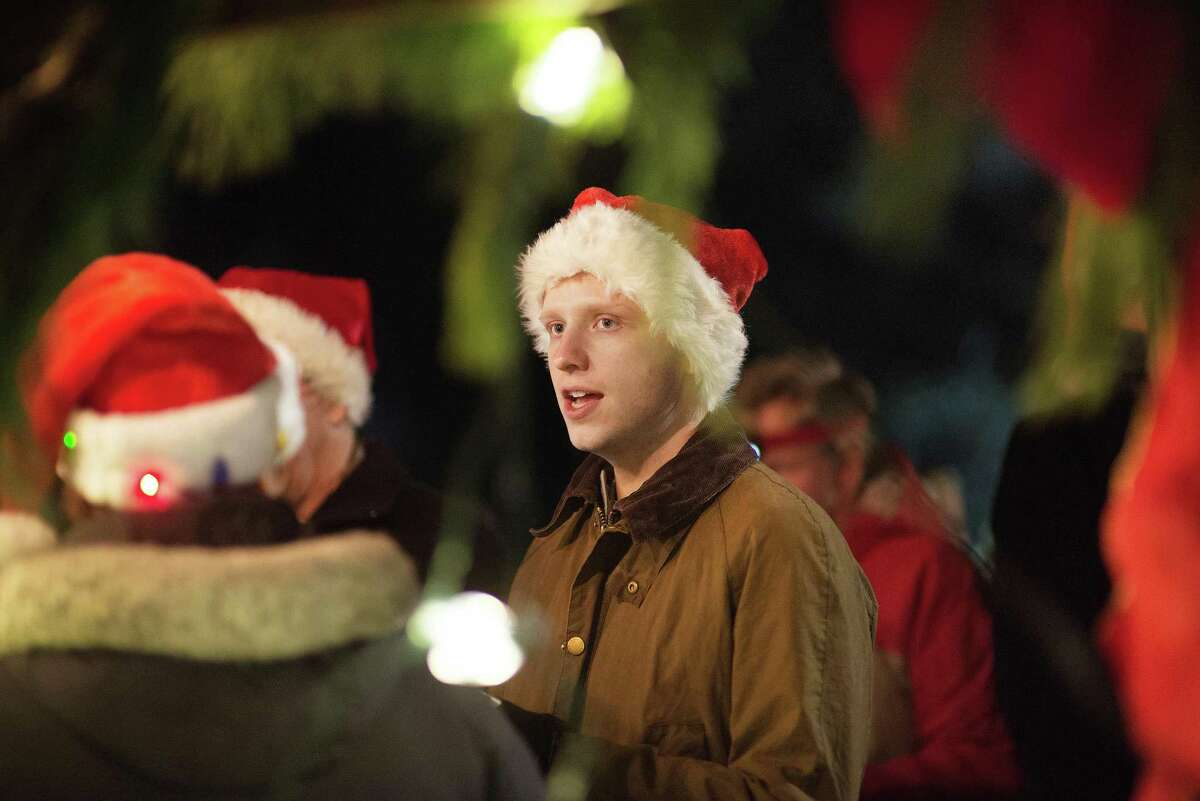 Townspeople sang Christmas carols on Christmas Eve, Dec. 24, 2019, at God's Acre in New Canaan, Conn.