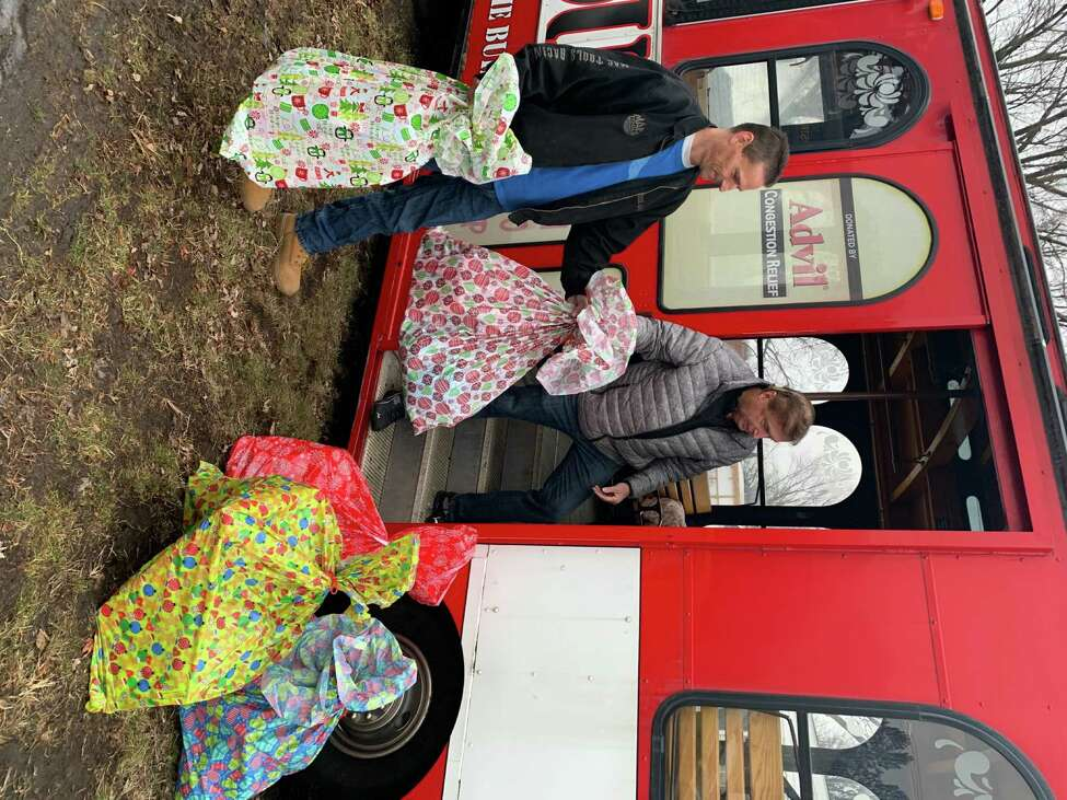 Courtesy of Victory Christian Church Pastor Charlie Muller and volunteers from Victory Christian Church deliver gifts for girls at St. Ann's Home for Girls on Christmas Eve.