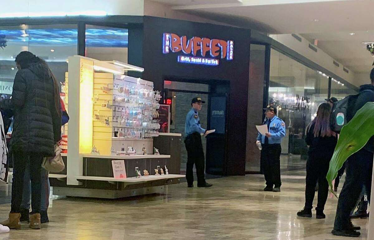 Mall security at the Connecticut Post Mall in Milford, Conn., on Friday, Dec. 27, 2019, walked around with printed out copies of the policy that went into effect at 3 p.m. and will continue throughout the weekend. The policy ensures anyone at the mall under the age of 18 be accompanied by an adult, age 21 or older.