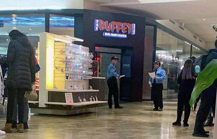 Mall security at the Connecticut Post Mall in Milford, Conn., on Friday, Dec. 27, 2019, walked around with printed out copies of the policy that went into effect at 3 p.m. and will continue throughout the weekend. The policy ensures anyone at the mall under the age of 18 be accompanied by an adult, age 21 or older. Photo: Hearst Connecticut Media / Tara O'Neill