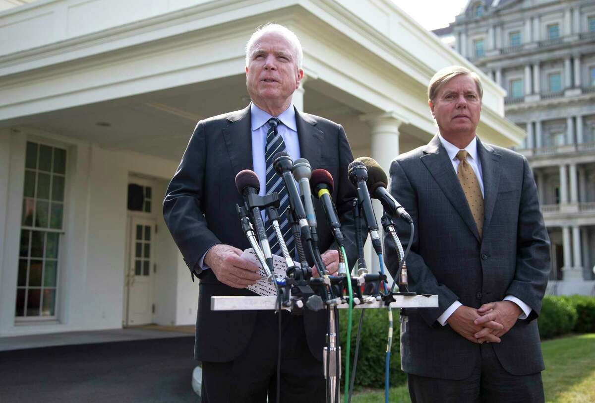 In 2013, Sens. John McCain and Lindsey Graham speak with reporters outside the White House after a meeting about Syria. A reader suggests Graham lost his moral bearings after the death of the Arizona senator.