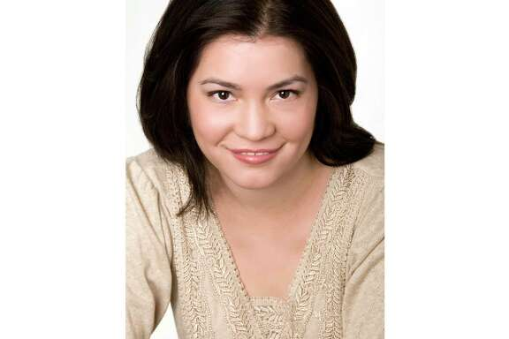 This undated image released by CourtneyMilan.com shows romance writer Courtney Milan. The Romance Writers of America, which bills itself as the voice of romance writers, has been upended over the way over the way it has treated Milan, a Chinese American writer. The association initially accepted the vote of its ethics committee that Milan had violated the group's code of ethics with negative online comments about other writers and their work.