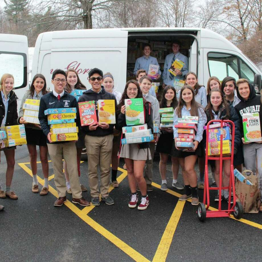 Immaculate High School students recently donated a school record of 1,633 boxes of cereal to the Dorothy Day Hospitality House's Morning Glory Program, which will feed the homeless breakfast for a full year. Photo: Contributed Photo / Contributed / The News-Times Contributed