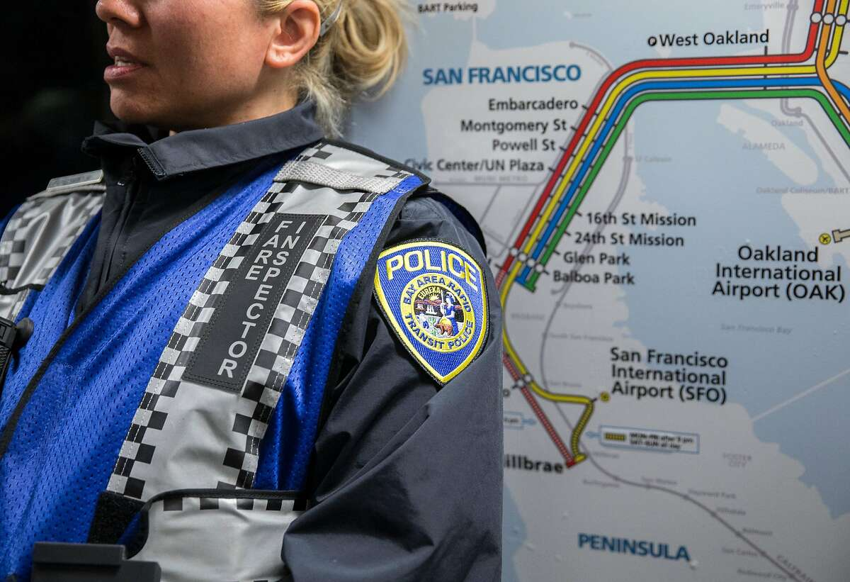 A Bart fare inspector leans against a transit map while patrolling a Daly City bound train during the morning commute in San Francisco, Calif. Thursday, May 31, 2018.