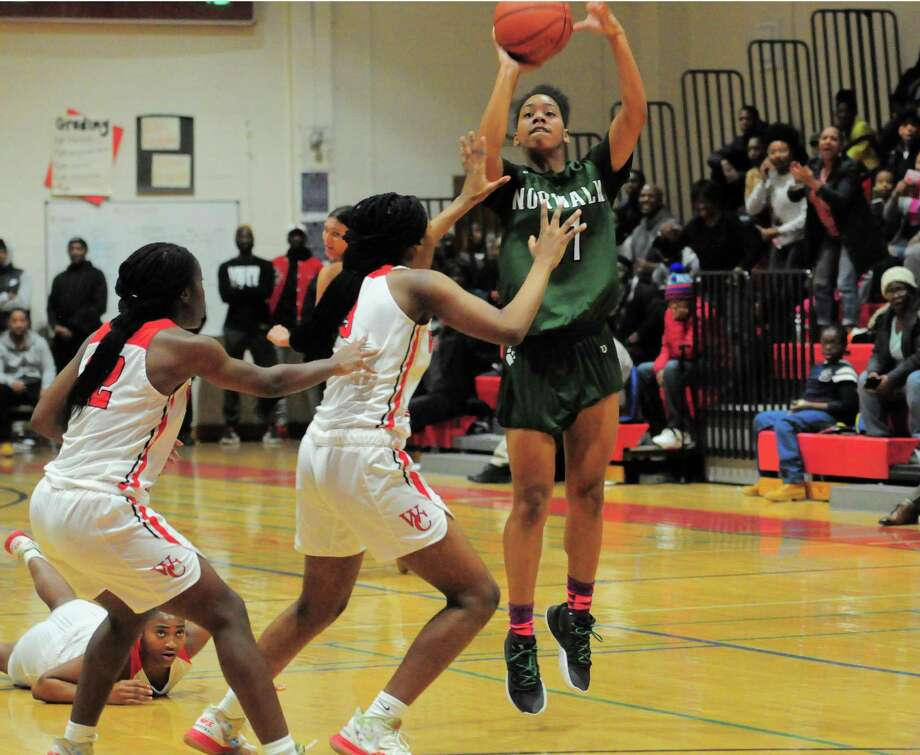 Norwalk's Anaijah Morgan releases a shot to win against Wilbur Cross during the Robert Saulsbury Invitational in New Haven on Friday. Photo: Christian Abraham / Hearst Connecticut Media / Connecticut Post