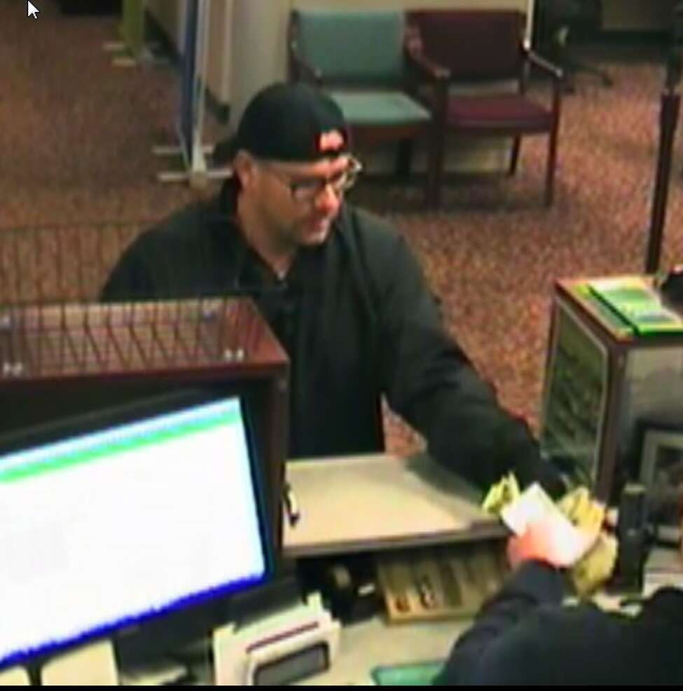 Colonie Police asked for the public's help when they investigated the robbery that occurred at Pioneer Savings Bank on the afternoon of Friday, Dec. 27, 2019. Christopher M. Seamans, 41, of East Syracuse has been charged with third-degree robbery and fourth-degree grand larceny in connection with the crime, according to Colonie police. Colonie Police are asking for the public's help as they investigate a robbery that occurred at Pioneer Savings Bank on the afternoon of Friday, Dec. 27, 2019. Anyone who recognizes this man should call 518-783-2754.