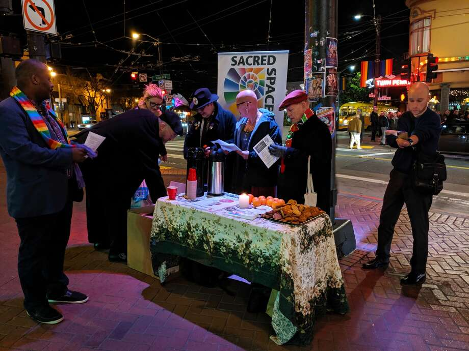 Sacred Space and the San Francisco Night Ministry hold a Christmas Eve mass for the queer and homeless in Harvey Milk Plaza. Photo: Dan Gentile / SFGate