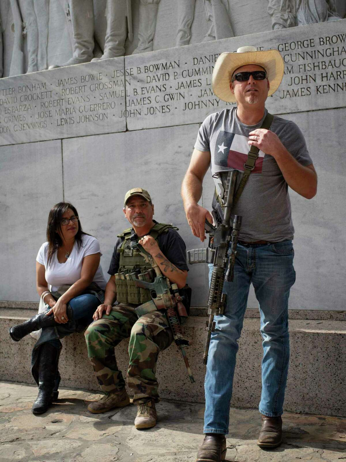 """Corey Harris, right, and Carlos Soliz, center, participate in an occupation of the Alamo Cenotaph carrying rifles in an attempt to stop to the city of San Antonio from moving the historical monument on Friday, December 27, 2019. Members of This is Texas Freedom Force are opposing the planned moving of the Alamo Cenotaph by the city of San Antonio. ?'We?•re here today to occupy around the Cenotaph to stop any plans moving forward, trying to disassemble it and move it,?"""" Brandon Burkhart, president of This is Texas Freedom Force (TITFF) said. TITFF is asking that Texas citizens be allowed to vote on the removal of the monument to the Battle of the Alamo and to those soldiers who died there, citing that the cost of movement and repair if it is damaged will cost Texas taxpayers."""