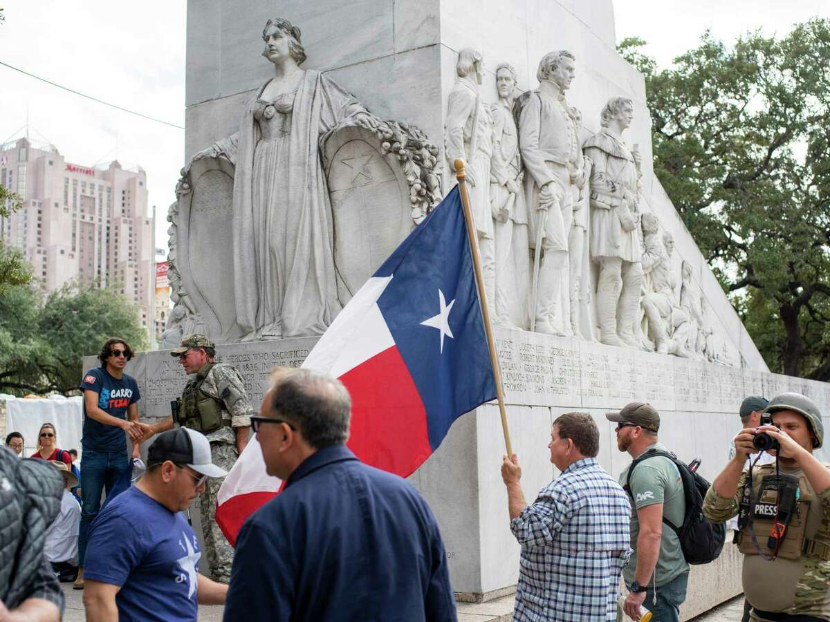 Members of the This is Texas Freedom Force and other supporters stage an Dec. 27 occupation of the Alamo Cenotaph to stop any movement of the monument by the city. The group and others have for years fought a proposed relocation of the memorial honoring the Texian and Tejano defenders of the fort who were killed in the famed 1836 battle.