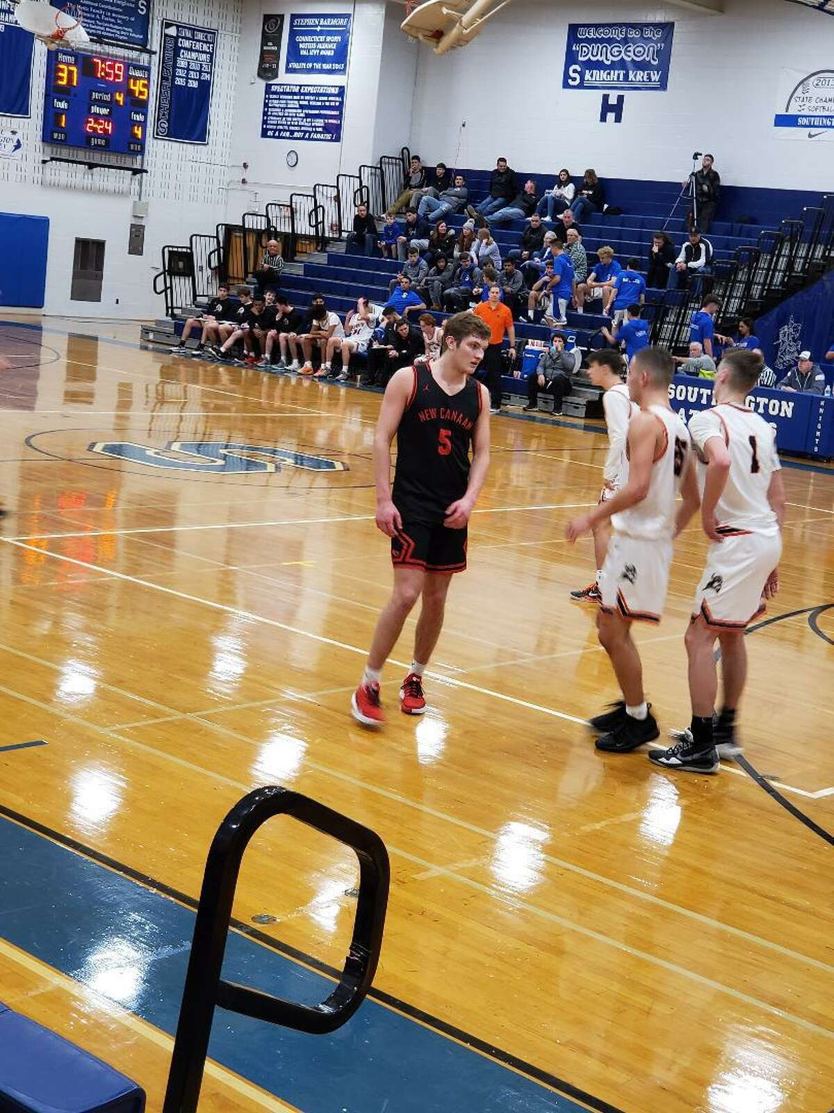 New Canaan's Alex Gibbens scored a game-high 26 points.