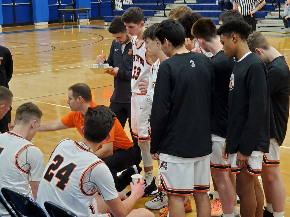 Shelton coach Brian Gardiner instructs his team during a time out.