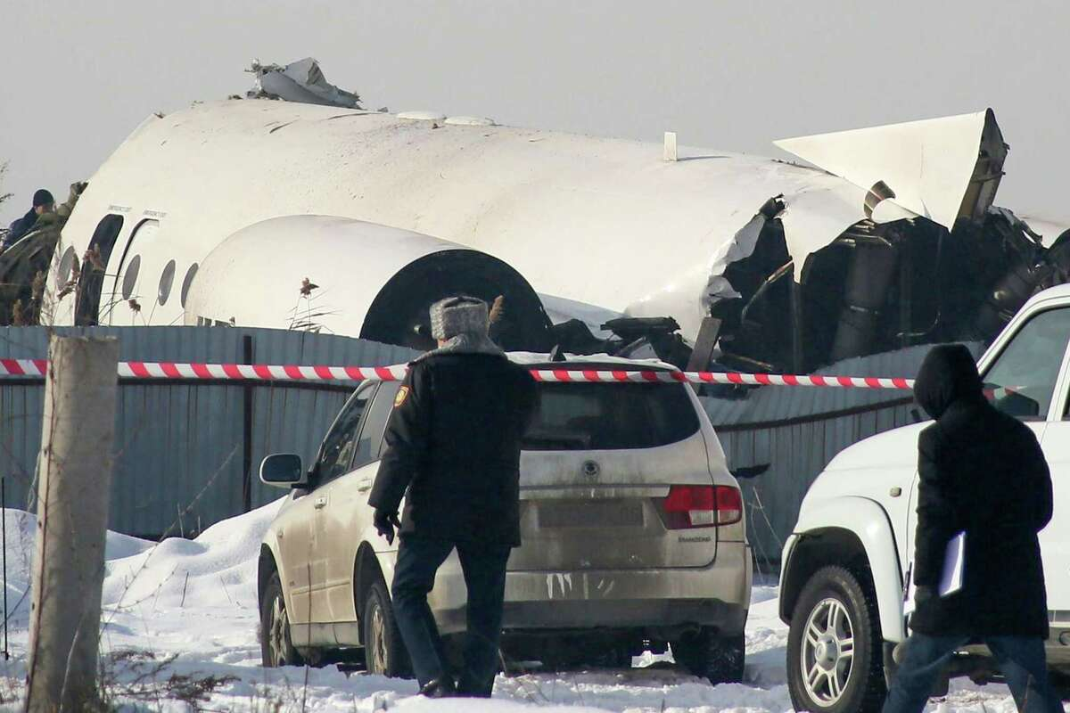 TOPSHOT - A view of the site of a passenger plane crash outside Almaty on December 27, 2019. - At least 15 people died on December 27, 2019 and dozens were reported injured when a passenger plane carrying 100 people crashed into a house shortly after takeoff from Kazakhstan's largest city. (Photo by Ruslan PRYANIKOV / AFP) (Photo by RUSLAN PRYANIKOV/AFP via Getty Images)