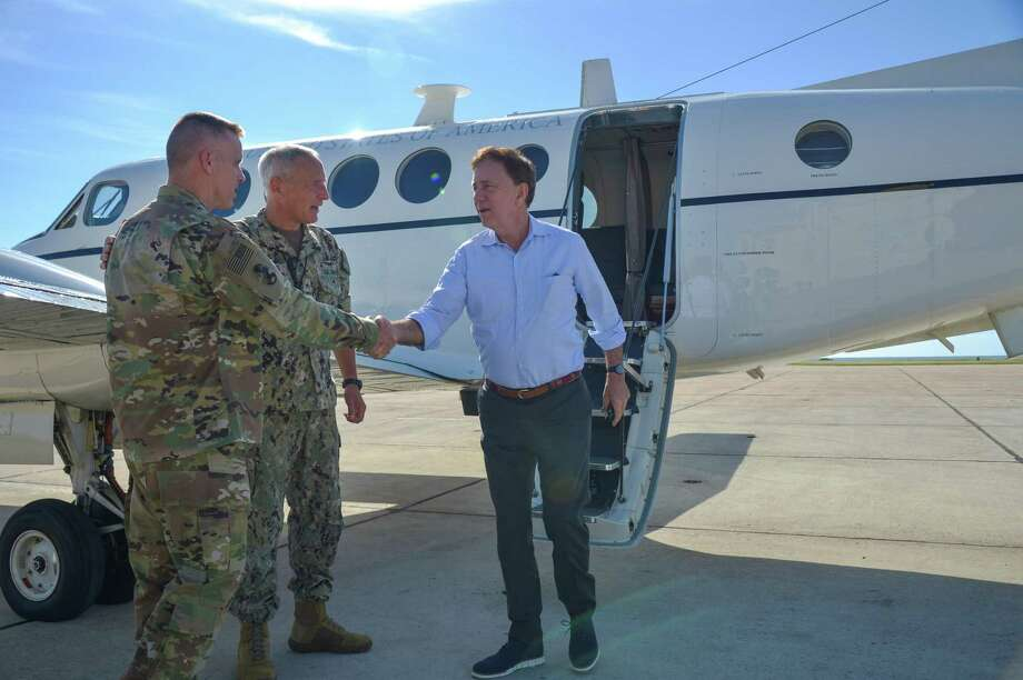 Gov. Ned Lamont arrives at Naval Station Guantanamo Bay, Cuba, to visit service members. Photo: Contributed Photo / Mass Communication Specialist Second Class Kevin J. Steinberg