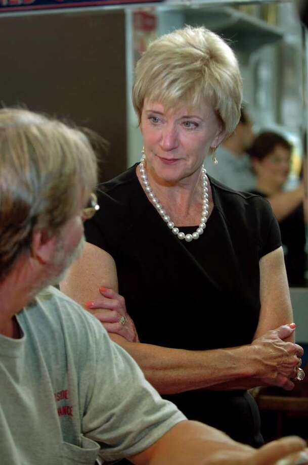 Republican senatorial candidate Linda McMahon spent some time touring small businesses in North Haven, Conn. on Wednesday August 11, 2010. Here, McMahon listens to the concerns of customer Michael Martindale, of Hamden, as he has breakfast at Scotty the Omelet King restaurant along Broadway in the town. Photo: Christian Abraham / Connecticut Post