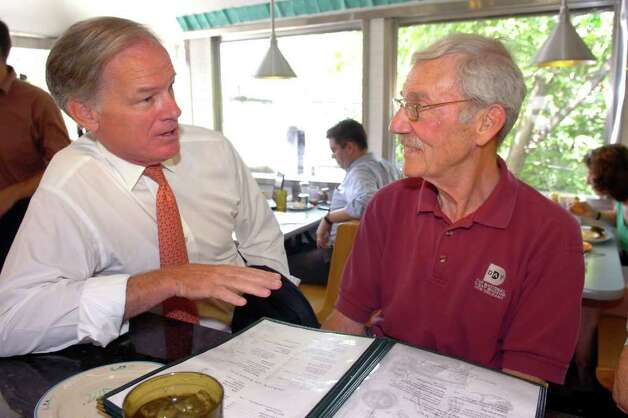 Republican candidate for Governor Tom Foley speaks with Jack Hennessey, of Meriden, at O'Rourke's Diner, in Middletown, Conn. Wed. Aug. 11th, 2010. Photo: Ned Gerard / Connecticut Post