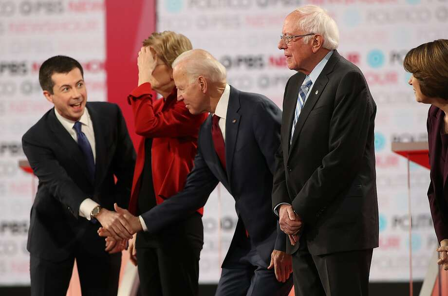 FILE - Democratic presidential candidate South Bend, Ind. Mayor Pete Buttigieg, left, shakes the hand of, Joe Biden as Sen. Elizabeth Warren (D-Mass.), and Sen. Bernie Sanders (I-Vt.),and Sen. Amy Klobuchar (D-Minn.) await the start of the Democratic presidential primary debate at Loyola Marymount University in Los Angeles on Thursday, Dec. 19, 2019. Photo: Brian Van Der Brug, TNS