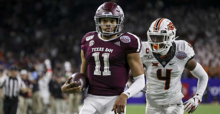 Texas A&M Aggies quarterback Kellen Mond (11) runs past Oklahoma State Cowboys cornerback A.J. Green (4) on his 67-yard touchdown run during the fourth quarter of the Texas Bowl at NRG Stadium on Friday, Dec. 27, 2019, in Houston. Photo: Jon Shapley/Staff Photographer