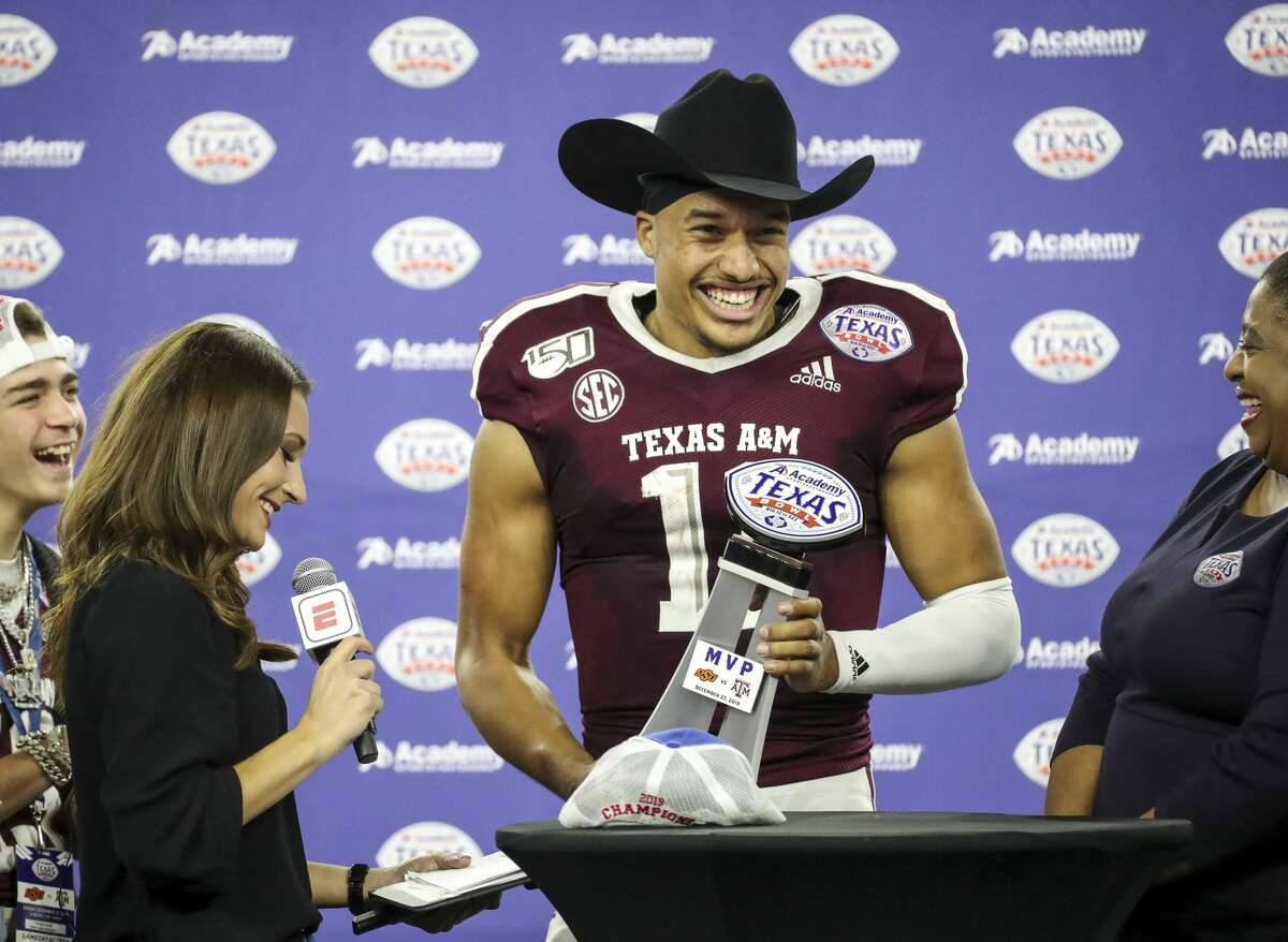 Texas A&M Aggies quarterback Kellen Mond (11) laughs on stage after the Texas A&M Aggies beat the Oklahoma State Cowboys in the Texas Bowl at NRG Stadium on Friday, Dec. 27, 2019, in Houston.