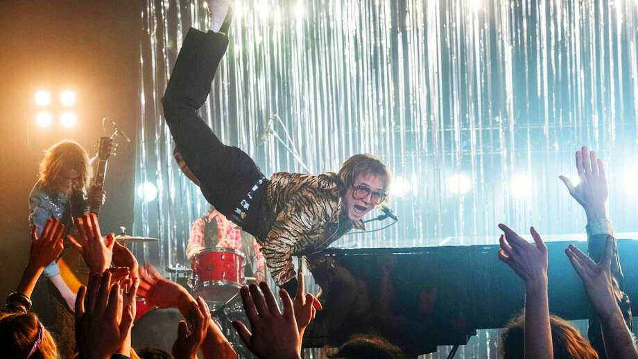"Taron Egerton stars as Elton John in ""Rocketman."" Photo: Marv Films/ Contributed Photo"
