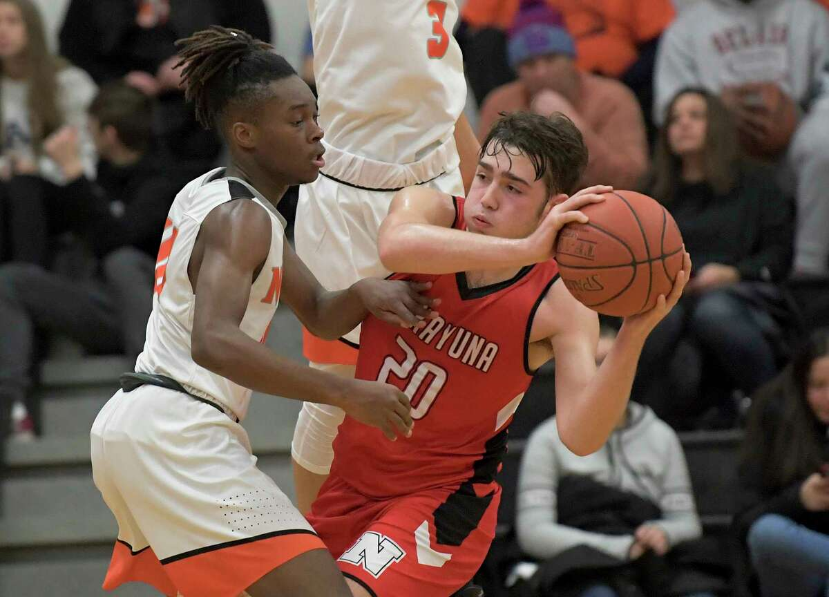 Mohonasen's Shawn Gillisslee (40) defends against Niskayuna's Gabe Eldaye (20) during a Section II high school basketball game Friday, Dec. 27, 2019, in Rotterdam, N.Y. (Hans Pennink / Special to the Times Union) ORG XMIT: 122819_hsbb2_HP111