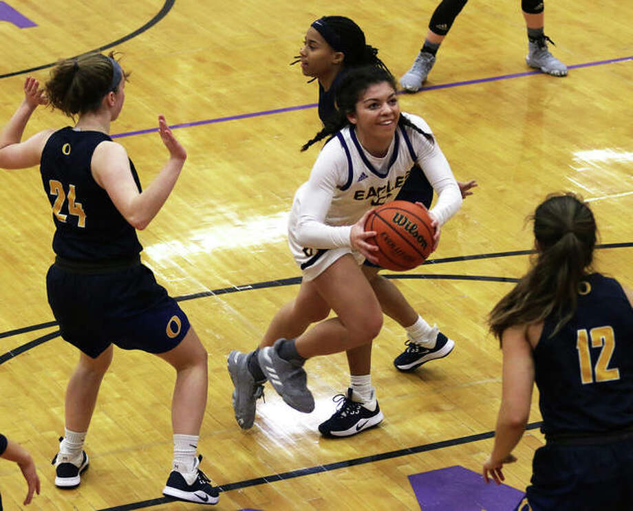 CM's Kourtland Tyus (middle) splits the O'Fallon defense to put up a shot in the lane during an Eagles' won at the CM/Adidas Shootout on Dec. 20 in Bethalto. Tyus scored 21 points Friday night to go over 1,000 for her career. Photo: Greg Shashack / The Telegraph