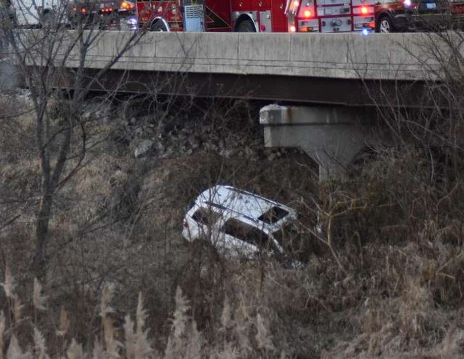 Emergency personnel from Edwardsville fire and police and Illinois State Police responded to a single-car crash on Friday afternoon. Photo: Tyler Pletsch | Hearst Illinois