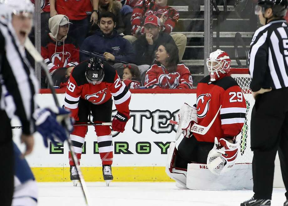 The Devils' Damon Severson (28) reacts after backhanding the puck past goalie Mackenzie Blackwood and into the net in OT. Photo: Bruce Bennett / Getty Images