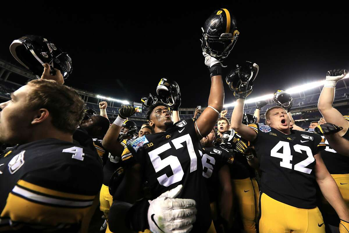 SAN DIEGO, CALIFORNIA - DECEMBER 27: The Iowa Hawkeyes celebrate after defeating the USC Trojans 49-24 in the San Diego County Credit Union Holiday Bowl at SDCCU Stadium on December 27, 2019 in San Diego, California. (Photo by Sean M. Haffey/Getty Images)