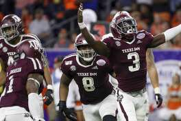 Texas A&M Aggies defensive lineman Tyree Johnson (3) celebrates after sacking Oklahoma State Cowboys quarterback Dru Brown (6) during the second quarter of the Texas Bowl at NRG Stadium on Friday, Dec. 27, 2019, in Houston.