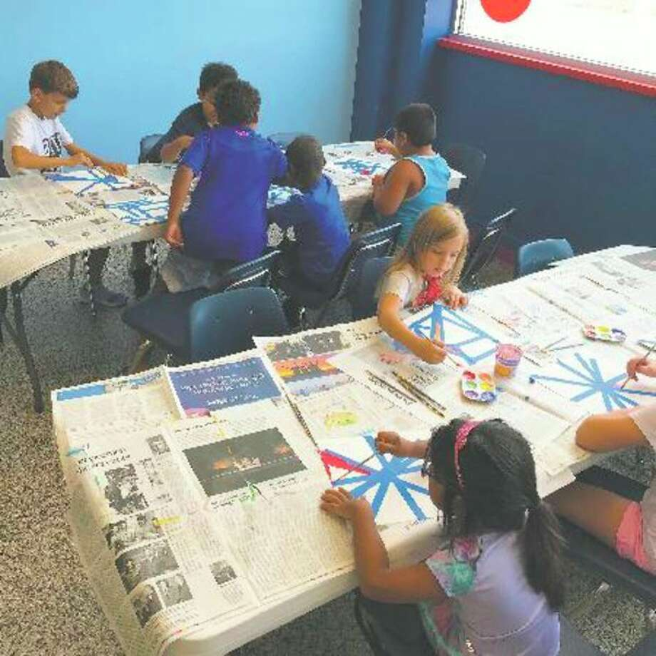 Children work on art projects at the Mid-Michigan Children's Museum. (Photo provided/Mid-Michigan Children's Museum)