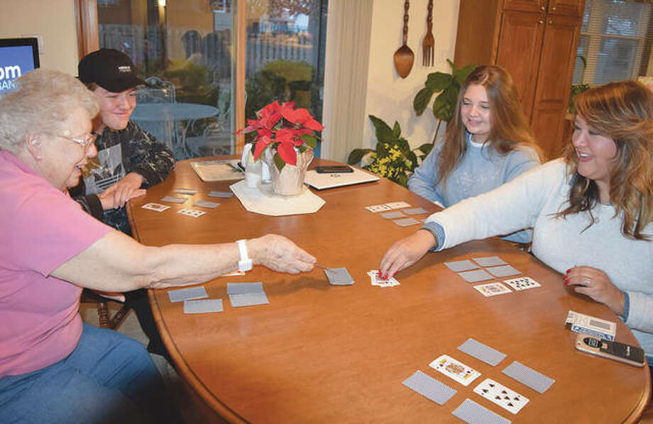 Deborah Van Heest (right) plays cards Christmas Eve with her family — her mother, Darlene Sills (from left); her son, Lorrne; and her daughter, Morrigan. Photo: Samantha McDaniel-Ogletree | Journal-Courier