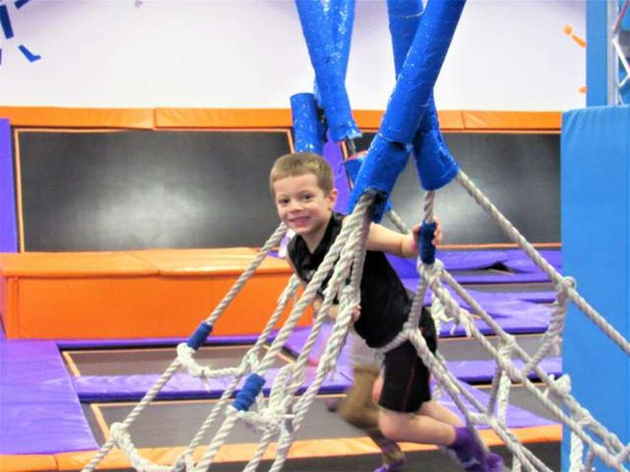 "Brantley Zurliene climbs the ropes at Altitude Trampoline Park where he said he enjoys ""everything."""