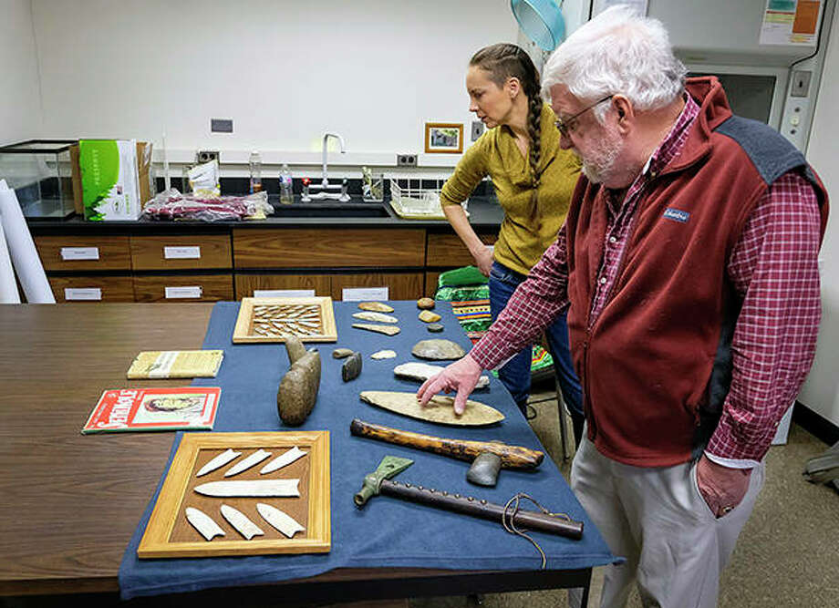 Tamira Brennan and Mark Wagner of SIU's Center for Archaeological Investigations look over artifacts believed to have originally been collected in Southern Illinois by Irvin Peithamnn. Photo: Byron Hetzler | Southern Illinoisan (AP)