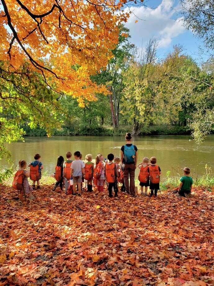 Nature Preschool students participate in an activity along the river. (Photo provided)