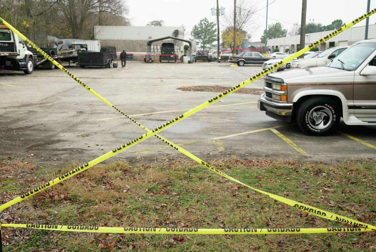 Police crime scene tape is shown in a parking lot Saturday, Dec. 28, 2019, in Houston in the 8500 block Sweetwater Lane where two people were shot and killed and at least seven others injured in a drive-by shooting while they were filming a music video Friday night.