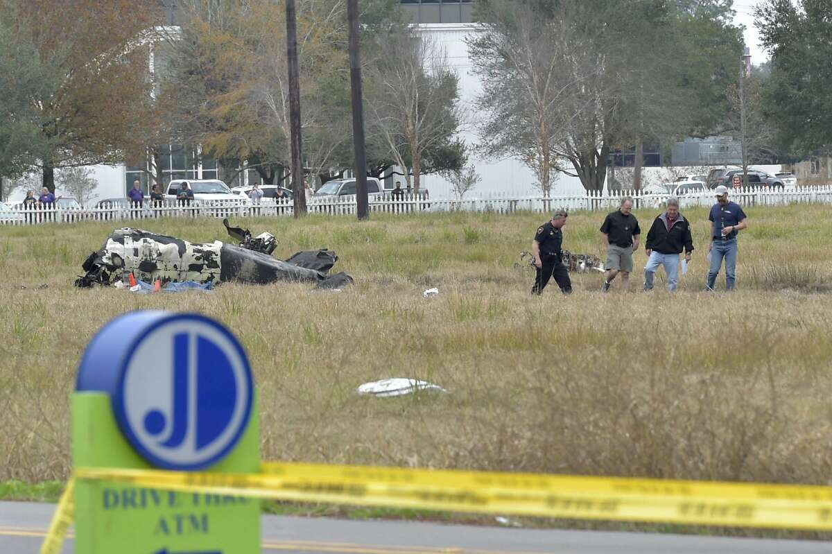 Investigators look over the site of a plane crash near Feu Follet Road and Verot School Road in Lafayette, La., Saturday, Dec. 28, 2019. Authorities confirmed the accident but details on whether anyone was injured was not immediately known.(Scott Clause/The Lafayette Advertiser via AP)
