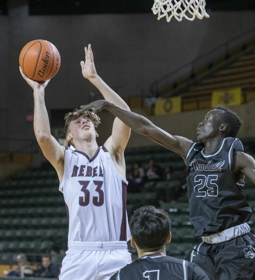 Lee's Jonathan Rabe pulls up for a shot as Canyon's Chol Bol defends 12/28/19 during a game in the 2019 Byron Johnston Holiday Classic at the Chaparral Center. Tim Fischer/Reporter-Telegram Photo: Tim Fischer/Midland Reporter-Telegram