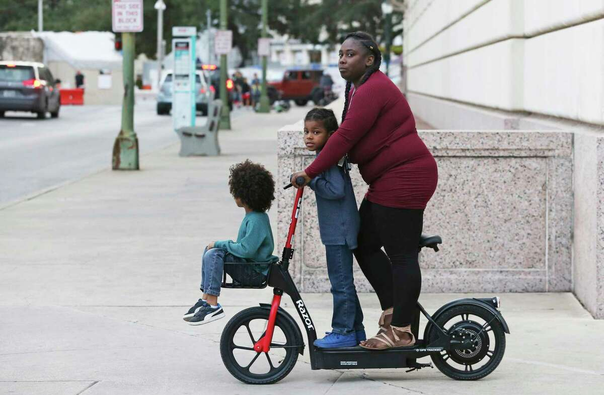 The City of San Antonio has passed regulations controlling the use of electric scooters, including one that prohibits riding double or triple, as in this photo from Dec, 27, 2019.