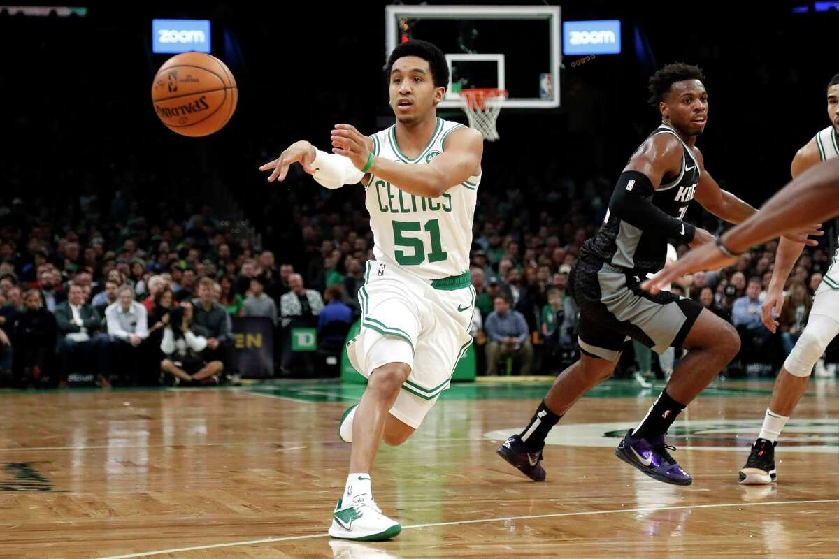 Boston Celtics' Tremont Waters passes during his NBA debut against the Sacramento Kings during the second quarter of an NBA game on Nov. 25 in Boston. Waters was named to the G League Second Team on Friday.