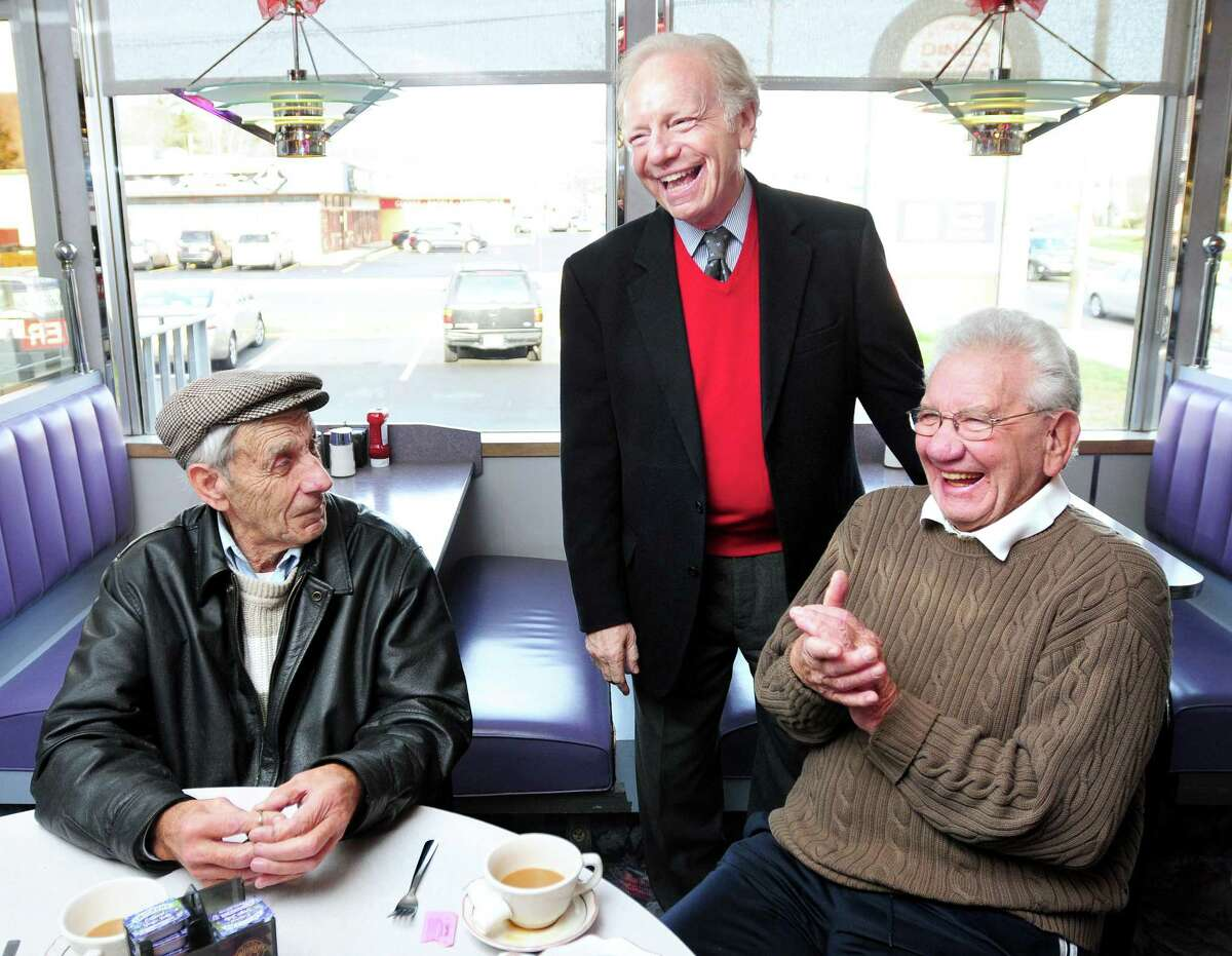 U.S. Sen. Joseph Lieberman talks with Robert Luciani, left, 80, of Woodbridge and Vito DeFrancesco, right, 82, of New Haven at the Athenian Diner in New Haven during a statewide tour of diners to say farewell on Dec. 26, 2012.