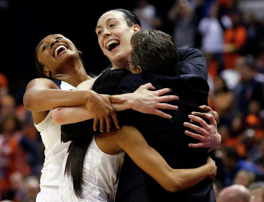 UConn's Morgan Tuck, left rear, Moriah Jefferson, front left, and Breanna Stewart hug coach Geno Auriemma, right, following the championship game against Syracuse in the women's Final Four in the NCAA college basketball tournament Tuesday, April 5, 2016, in Indianapolis. Connecticut won 82-51. Photo: AJ Mast / Associated Press / FR123854 AP