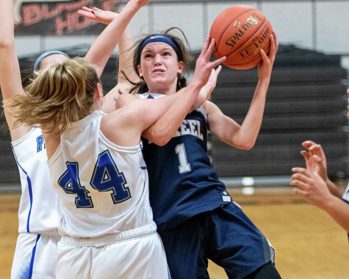 Mekeel Christian's Avery Mills draws a foul from Hoosick Falls senior Madeline Walker during the Mohonasen Holiday Classic in 2019. Mills is now thriving at national power Winston-Salem Christian. (Jim Franco/Special to the Times Union)