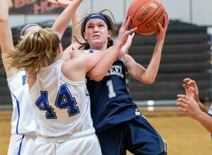 Mekeel Christian eighth grader Avery Mills draws a foul from Hoosick Falls senior Madeline Walker during the Mohonasen Holiday Classic at Mohonasen High School on Saturday, Dec. 28, 2019 (Jim Franco/Special to the Times Union.)